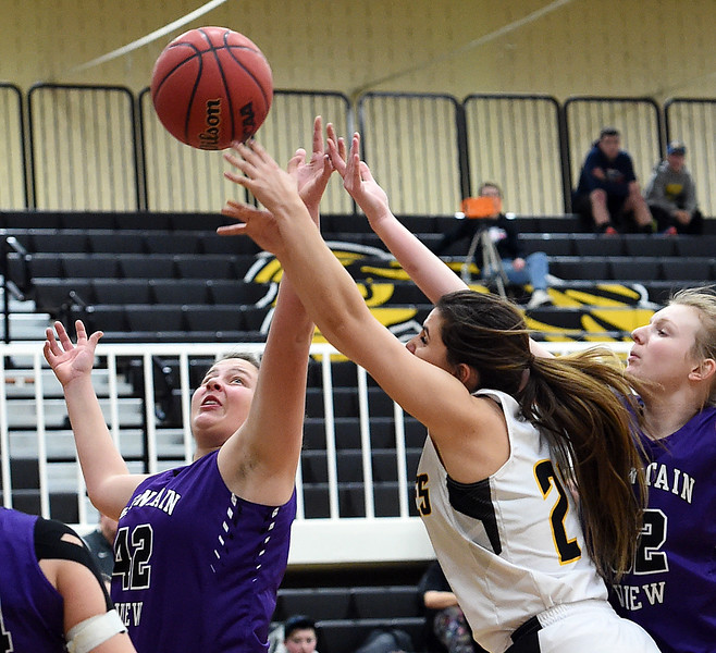 Thompson Valley's #21 Kate Robinson and Mountain View's #32 Brynne Rydbom go up for a rebound during their game Friday, Jan. 27, 2017, at Thompson Valley High School in Loveland.   (Photo by Jenny Sparks/Loveland Reporter-Herald)