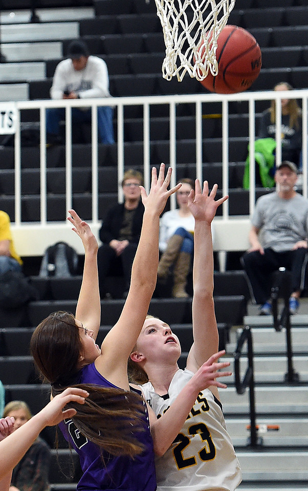 Thompson Valley's #23 Sydnee Durtsche goes up for a shot as Mountain View's #21 Madison Langman tries to block during their game Friday, Jan. 27, 2017, at Thompson Valley High School in Loveland.   (Photo by Jenny Sparks/Loveland Reporter-Herald)