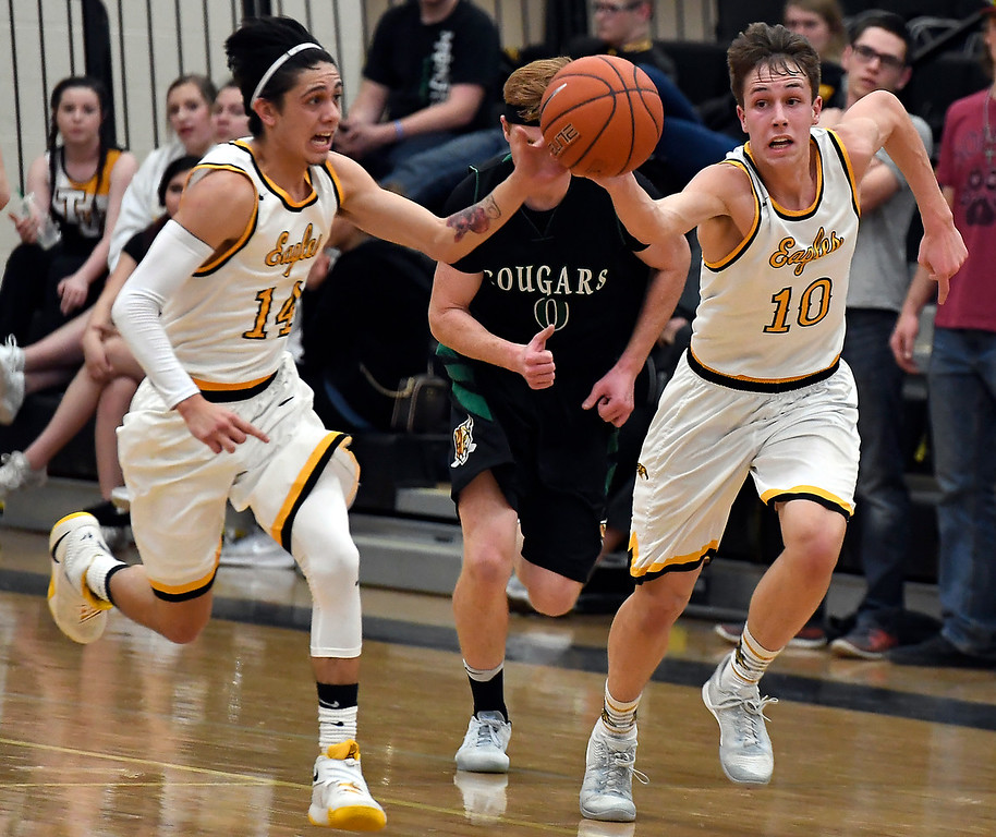 Thompson Valley's #14 Julian Espinoza passes to #10 Justin Wiersema during their game aganst Niwot Thursday, Feb. 9, 2017, at Thompson Valley High School in Loveland.  (Photo By Logan O'Brien/ Loveland Reporter-Herald)
