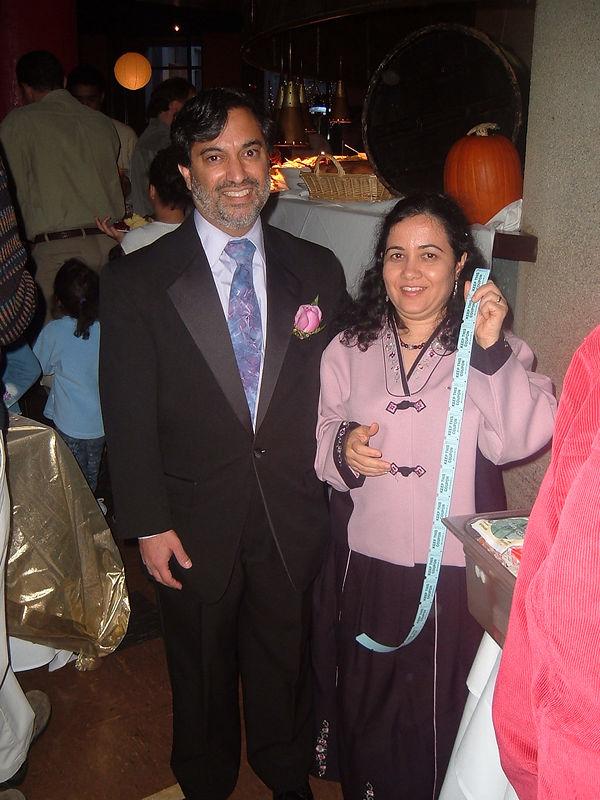 Sangeeta with raffle tickets and Dilip [by Eleni Vlachos]