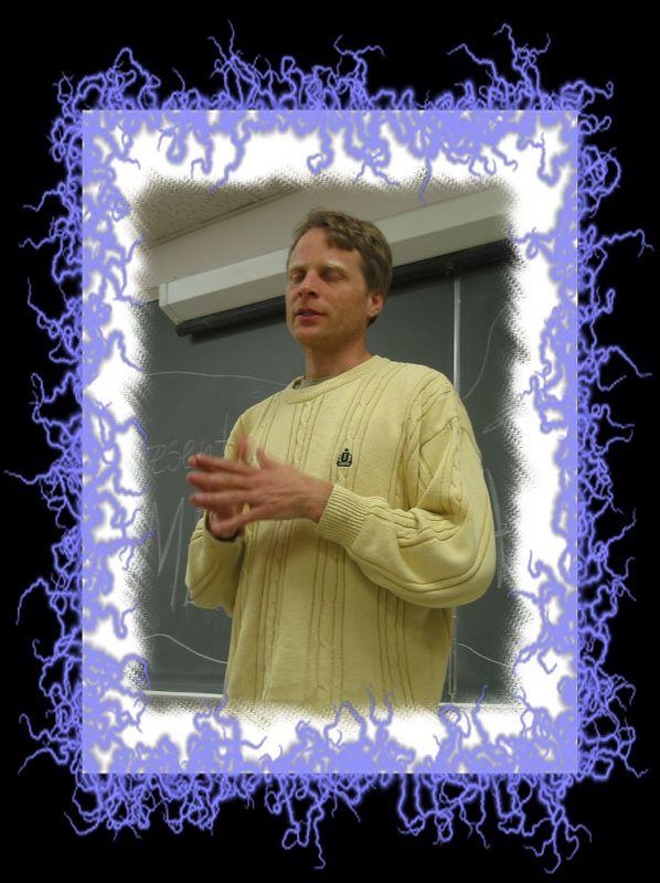 Erik speaking at NCSU 2 [edgeframe and fibrous iris blue psy_9 frames]