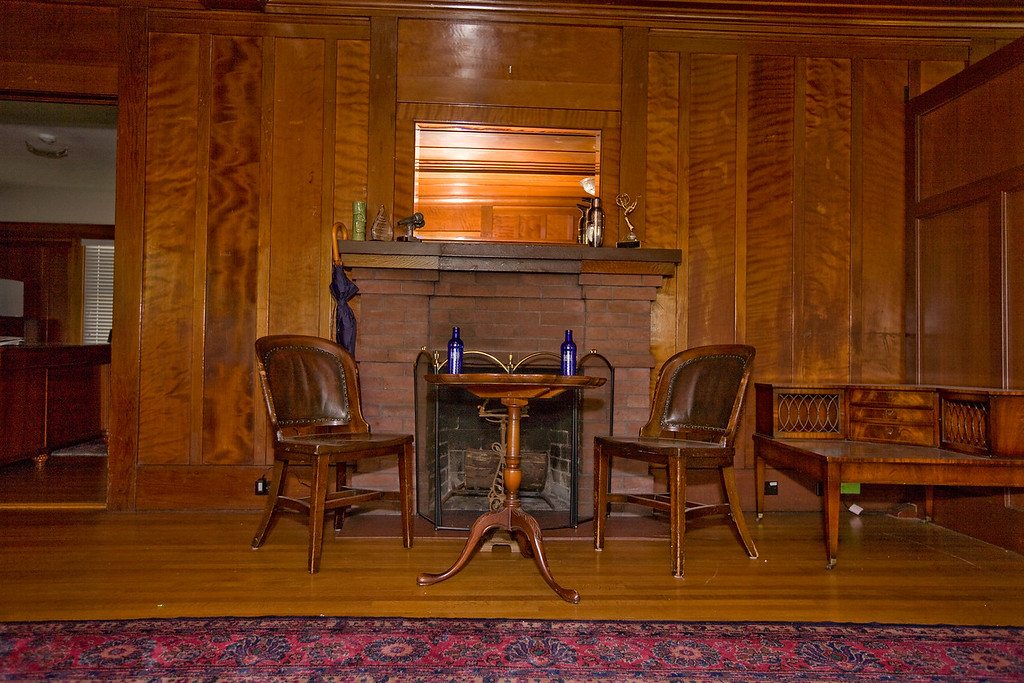 I envision an electric fire in the fireplace and two wing chairs for two person interviews.