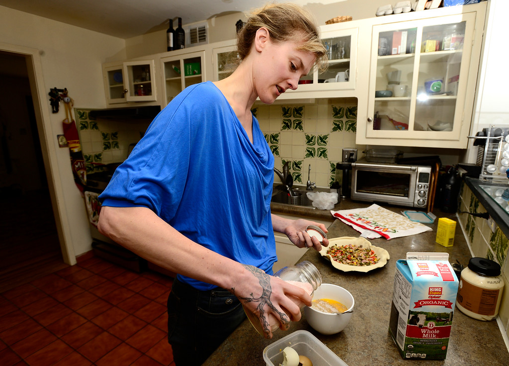 . Tabitha Farrar adds ingredients including mustard powder, whole organic milk, and salt and pepper to her quiche in her Boulder home on Thursday. For more photos go to www.dailycamera.com Paul Aiken Staff Photographer Feb 16 2017