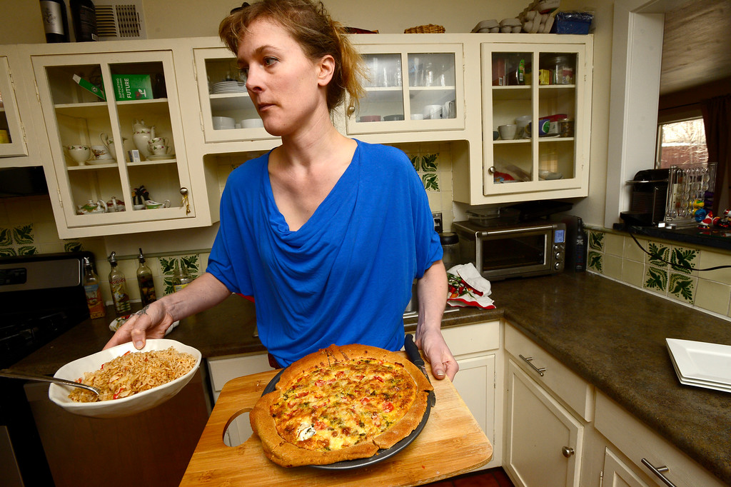 . Tabitha Farrar carries her finished quiche away from her oven to be served in her Boulder home on Thursday. For more photos go to www.dailycamera.com Paul Aiken Staff Photographer Feb 16 2017