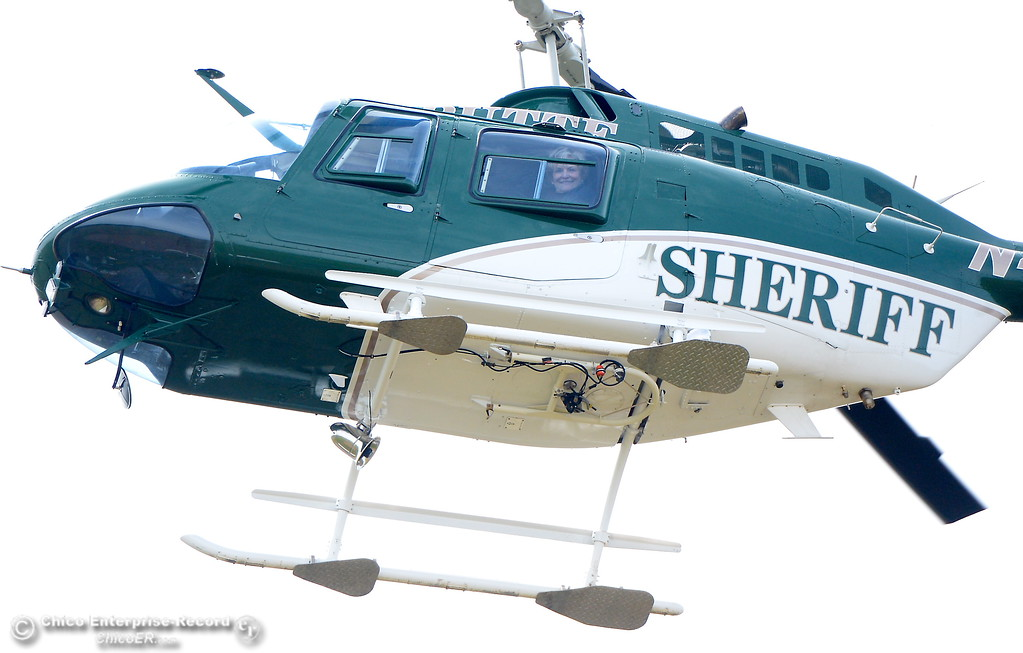. An injured hiker is brought back to the parking lot at Table Mountain in the Butte County Sheriff\'s helicopter Thursday April 5, 2018.  (Bill Husa -- Enterprise-Record)
