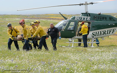 An injured hiker is transfered from the Butte County Sheriff's helicopter to medics and a waiting ambulance at Table Mountain in Oroville, Calif. Thursday April 5, 2018.  (Bill Husa -- Enterprise-Record)
