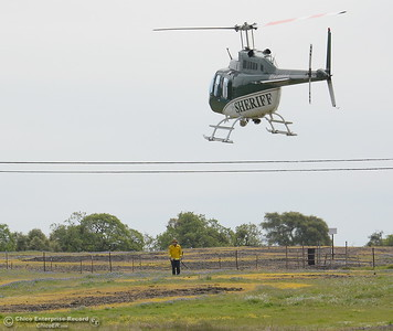 An injured hiker is brought back to the parking lot at Table Mountain in the Butte County Sheriff's helicopter Thursday April 5, 2018.  (Bill Husa -- Enterprise-Record)