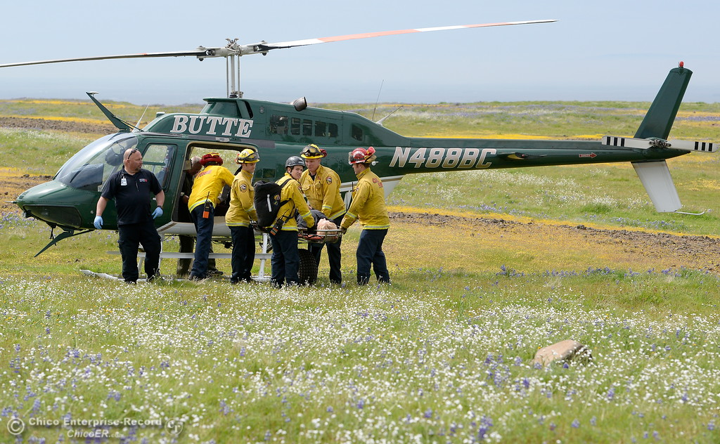 . An injured hiker is transfered from the Butte County Sheriff\'s helicopter to medics and a waiting ambulance at Table Mountain in Oroville, Calif. Thursday April 5, 2018.  (Bill Husa -- Enterprise-Record)