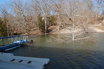 ...unless he has a kayak, like ours. We tied a rope to the back of it, and used it as a ferry. Normally the tree in the foreground is just out of the water.