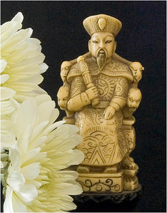 "The chrysanthemum is special to the Japanese, so I chose it for the foreground of this shot of a 3.5"" carved figure.  The throne of the Emperor of Japan is called ""The Chrysanthemum Throne"".  The Imperial Seal of Japan bears a chrysanthemum, and the flower frequently appears in Japanese art and pottery.  The flower was first cultivated in China, though."