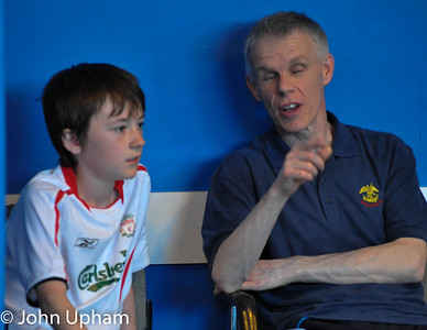 Tony explains the finer points of tennis de table to a young player