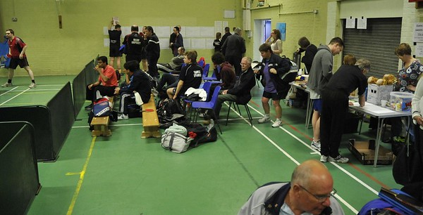 Spectators follow the action on Table One.