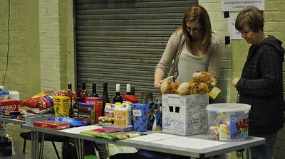"Sue Tompsett and Barbara Evans survey the prizes and organise the ""Guess the Teddys Name"" raffle draw."