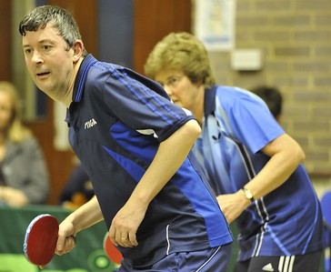 Sean Pickin and Terri Allison demonstrate synchronised table tennis during the mixed doubles final.