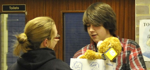 Sue Tompsett gives ? the Teddy Bear to his new owner, Charlie Morrison.