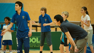 """Michael Chan organises a game of table tennis """"cricket"""" with the youngsters."""