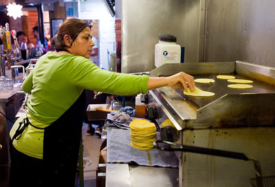 Maria Guerrero cooks tortillas made from masa dough at T/ACO in Boulder.   For more photos go to www.dailycamera.com (Autumn Parry/Staff Photographer) May 18, 2016