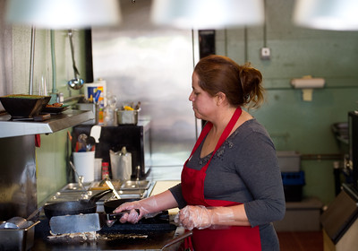Co-owner Josie Payan cooks chicken for an order of tacos in the kitchen at Benny's Tacos in Longmont on Wednesday. For more photos go to www.dailycamera.com (Autumn Parry/Staff Photographer) May 18, 2016