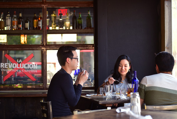 "From left to right, James Lee, Esther Cha and Michael Silva enjoy lunch at La Revolución Taqueria y Cantina in Louisville on Thursday.<br /> For more photos go to  <a href=""http://www.dailycamera.com"">http://www.dailycamera.com</a><br /> (Autumn Parry/Staff Photographer)<br /> May 19,2016"