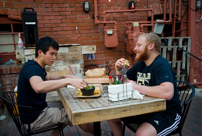 Bryan Lee (left) and Josh Gewirtz enjoy dinner at T/ACO in Boulder on Thursday. For more photos go to www.dailycamera.com (Autumn Parry/Staff Photographer) May 18, 2016