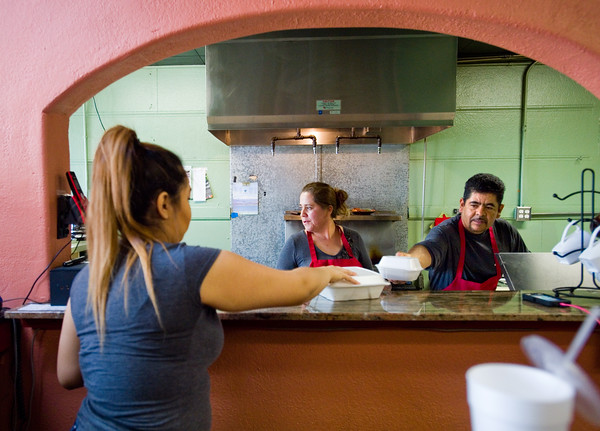"""Co-owner  Josie Payan and Benny Payan pass off orders to the waitress at Benny's Tacos in Longmont.<br /> For more photos go to  <a href=""""http://www.dailycamera.com"""">http://www.dailycamera.com</a><br /> (Autumn Parry/Staff Photographer)<br /> May 18, 2016"""