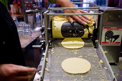 Maria Guerrero uses a tortilla roller to turn masa into tortillas for tacos at T/ACO in Boulder. For more photos go to www.dailycamera.com (Autumn Parry/Staff Photographer) May 18, 2016