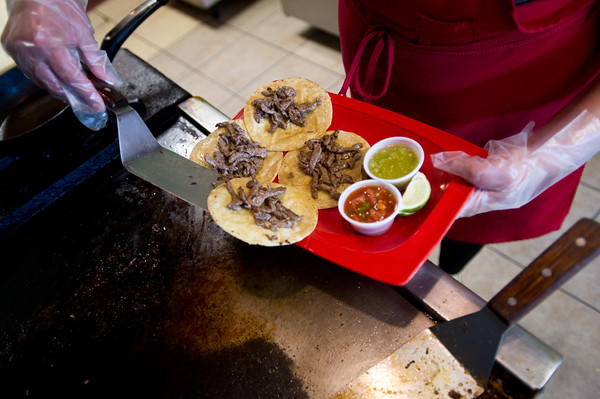 """Co-owner Josie Payan cooks up an order of tacos with azada at Benny's Tacos in Longmont on Wednesday.<br /> For more photos go to  <a href=""""http://www.dailycamera.com"""">http://www.dailycamera.com</a><br /> (Autumn Parry/Staff Photographer)<br /> May 18, 2016"""