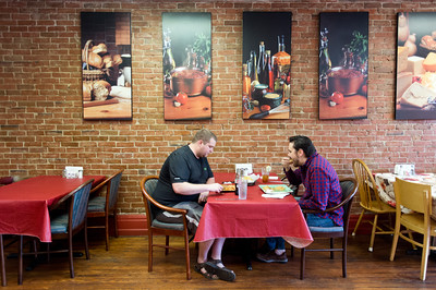 Evan Lund (left) enjoys lunch with Matt Watt at Benny's Tacos in Longmont on Wednesday. For more photos go to www.dailycamera.com (Autumn Parry/Staff Photographer) May 18, 2016