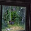 Blacksmith shop as seen through broken window