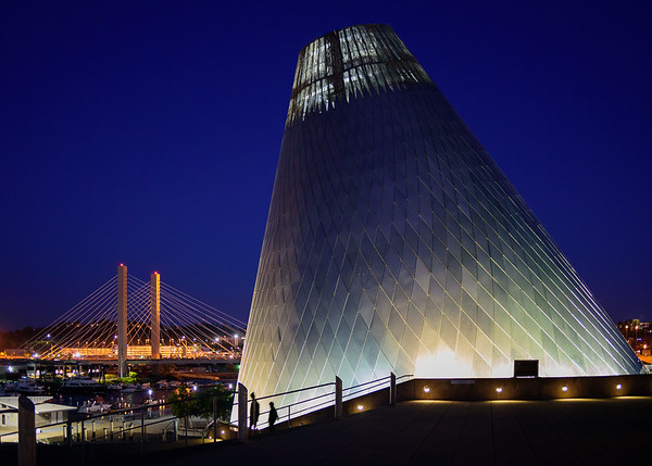 The tower on the Tacoma Museum of Glass seems to hover over the Twenty First Street bridge along the Foss Waterway in Downtown Tacoma.