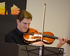 DAVID LACHANCE — BENNINGTON BANNER<br /> Violist Ariel Rudiakov performs during the Taconic Chamber Players concert at the Vermont Veterans' Home.