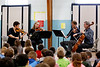 HOLLY PELCZYNSKI - BENNINGTON BANNER Members of the Taconic Chamber Players entertain and educate students at Monument Elementary school on Friday afternoon in Bennington.  From left to right. Violinist Heather Braun-Bakken, Violinist Joana Genova, Ariel Rudiakov, on viola, and  Cellist Natheniel Park.