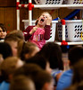 HOLLY PELCZYNSKI - BENNINGTON BANNER  Second grader Katerina Leonetti mimics the movements of a violinist during a fast paced classical piece during a visit from the classical music quartet, The Taconic Chamber Players on Friday afternoon at Monument Elementary school.
