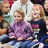 HOLLY PELCZYNSKI - BENNINGTON BANNER Monument Elementary School kindergartners Madeline Brady and Kaydence Griffis dance and create percussion while slapping their legs while listening to music of the Taconic music players on Tuesday during a educational concert series.