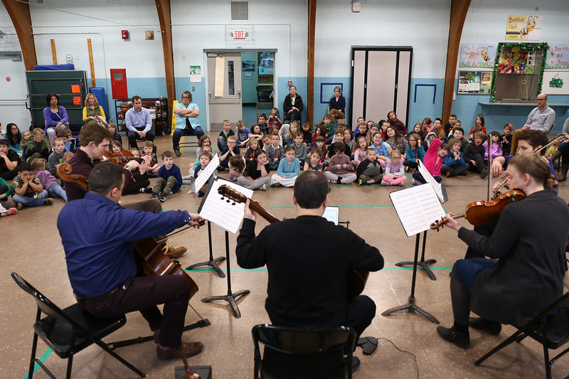 """HOLLY PELCZYNSKI - BENNINGTON BANNER Members of the Taconic music group play for students at Monument Elementary School on Tuesday morning in Bennington. The visit from the Manchester based group is part of a educational series called """", Taconic Music in Action"""" teaching students the joy of music through education and concerts."""