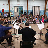 "HOLLY PELCZYNSKI - BENNINGTON BANNER Members of the Taconic music group play for students at Monument Elementary School on Tuesday morning in Bennington. The visit from the Manchester based group is part of a educational series called "", Taconic Music in Action"" teaching students the joy of music through education and concerts."