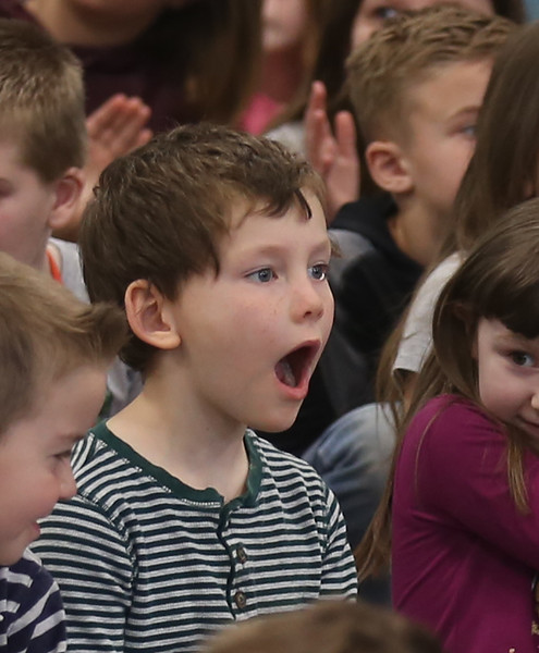 """HOLLY PELCZYNSKI - BENNINGTON BANNER First grader John Trafton jaw drops while listening to classical music created by the Taconic Music players out of Manchester , on Tuesday at Monument Elementary School in Bennington. The visit from the Manchester based group is part of a educational series called """", Taconic Music in Action"""" teaching students the joy of music through education and concerts."""