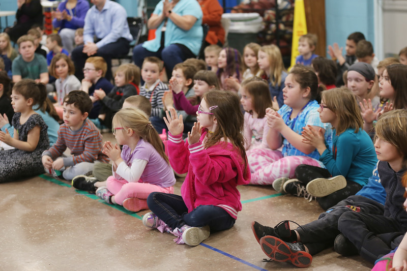 """HOLLY PELCZYNSKI - BENNINGTON BANNER Students at Monument Elementary School clap to classical music on Tuesday morning in Bennington. The visit from the Manchester based group is part of a educational series called """", Taconic Music in Action"""" teaching students the joy of music through education and concerts."""
