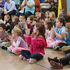 "HOLLY PELCZYNSKI - BENNINGTON BANNER Students at Monument Elementary School clap to classical music on Tuesday morning in Bennington. The visit from the Manchester based group is part of a educational series called "", Taconic Music in Action"" teaching students the joy of music through education and concerts."