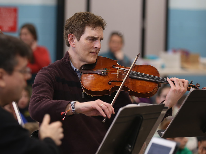 HOLLY PELCZYNSKI - BENNINGTON BANNER Ariel Rudiakov, viola and Artistic Director with the Taconic Music players plays the violin for students at Monument Elementary School on Tuesday in Bennington.