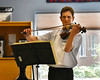 HOLLY PELCZYNSKI - BENNINGTON BANNER  Ariel Rudiakov plays some soothing tunes for veterans on his viola, on Wednesday afternoon.