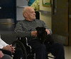 """HOLLY PELCZYNSKI- BENNINGTON BANNER Chapin Darling pets his dog as he listens to The Taconic Chamber Players on Wednesday afternoon in the """"Freedom Village""""  at the Vermont Veterans Home which is exclusively cares for those with dementia and Alzheimer's."""