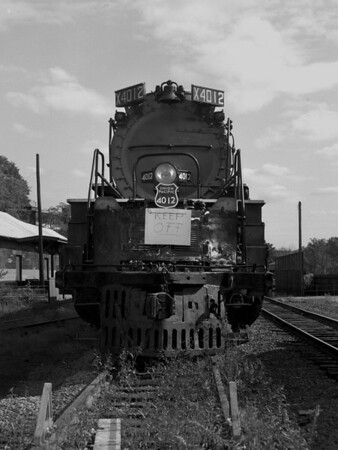 "UP Big Boy 4012 - Greenfield, MA (?) in transit to Steamtown, Bellows Falls, VT. Banner reads ""I'm the largest loco in the world going to Steamtown, Bellows Falls VT"".  TAA-ST-011-5_K"