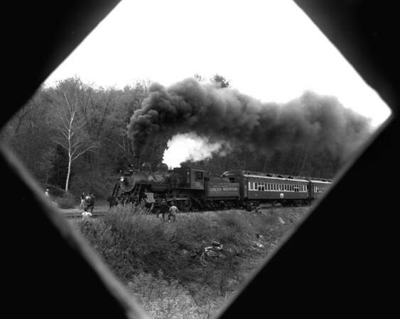#89 framed through Bartonsville covered bridge.  TAA-ST-034-1_K