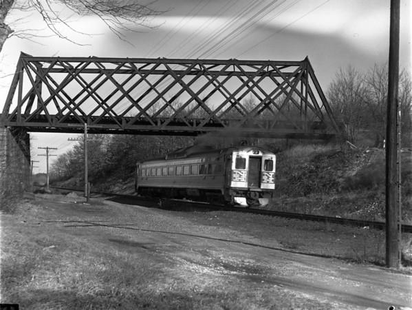 NH Budd Car at B&A Webster Branch bridge, North Webster, MA. - TAA-NH-005-1K