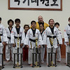 Congratulations to the new first degree black belts (front row)