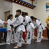 Lauren and four other classmates being welcomed by senior black belt members from her school
