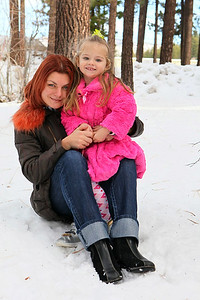 Mom with kid in the snow