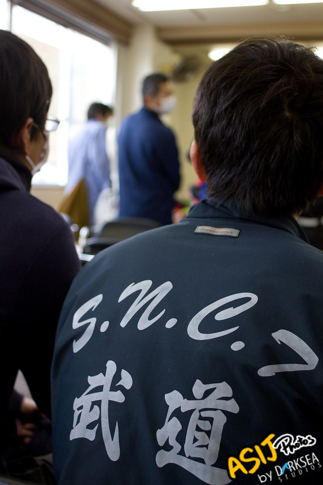 Local martial arts students wait in line at the volunteer center.<br /> <br /> Photo by: Tai Dirkse