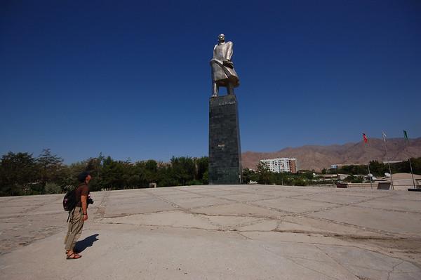 Tajikistan, Khojand: Emilie staring at big Lenin.